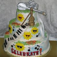 Celebrate! I was asked to create a cake for a newly married musical couple's celebration. The cake was frosted with buttercream icing. The banjo...