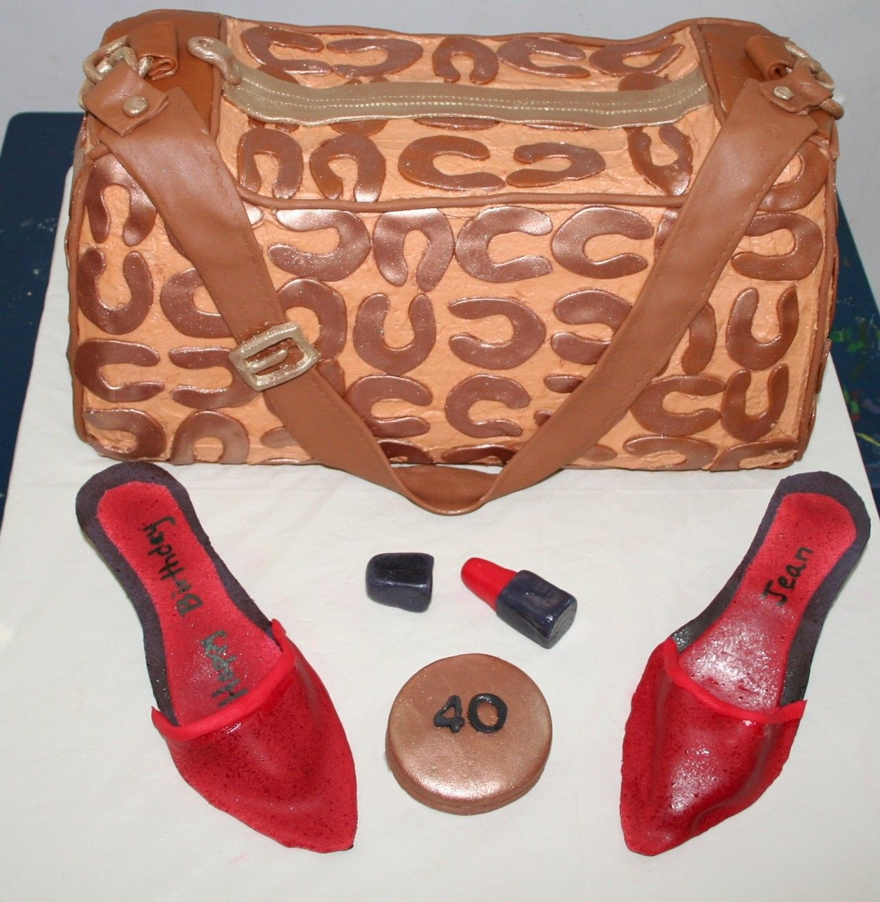 Coach Bag With Red Shoes Buttercream icing with fondant accents. Shoes and accesories are fondant