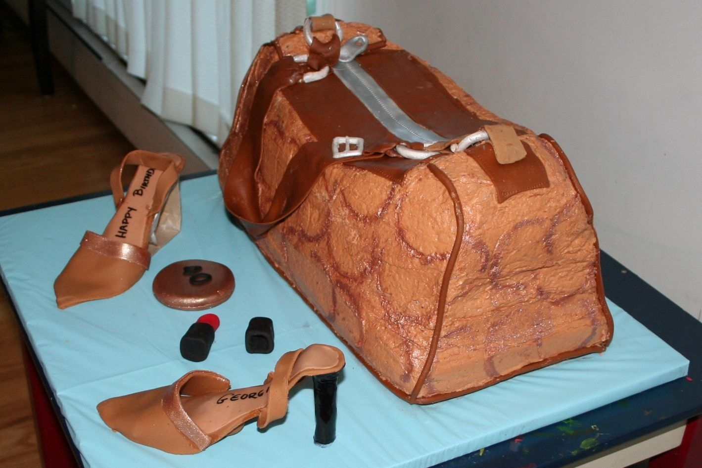 Coach Purse/bag Buttercream with Fondant Accents. Shoes and accesories are fondant