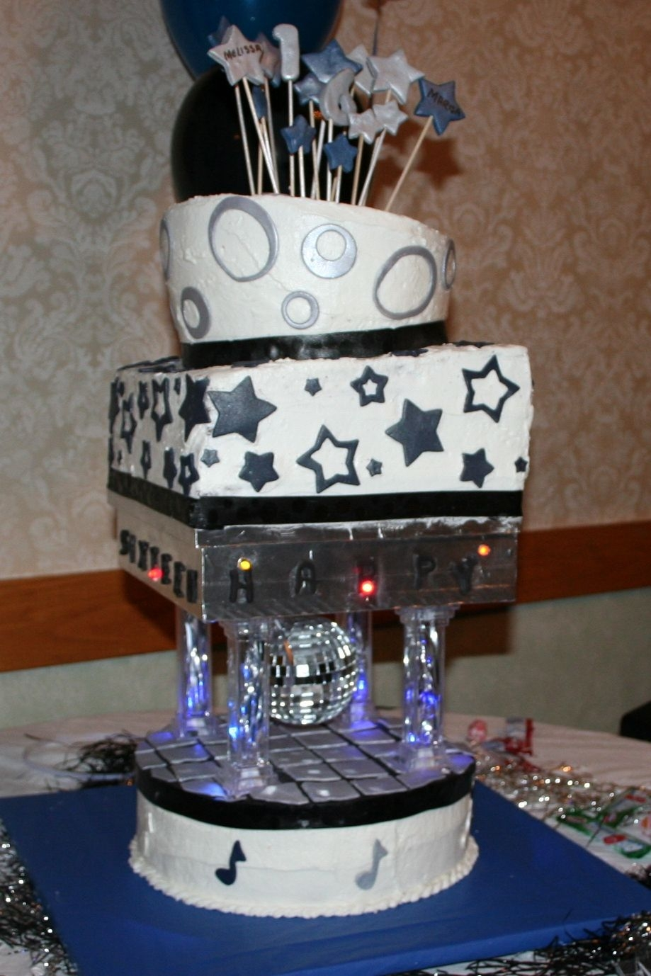 Sweet 16 working lights,revolving disco ball buttercream with fondant accents