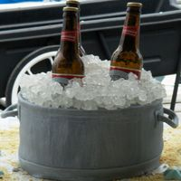Bucket Of Bud  Grooms cake i made for a wedding today. the ice is rock candy and the bottles are real. not time to make them from sugar. i was happy with...