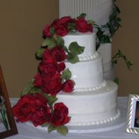 Red Roses Per Brides request roses are fake - she wanted to be able to reuse them. Cool idea! White cake w/ buttercream icing - this is the 1st...