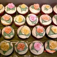 Bridal Shower Cupcakes White chocolate cupcakes with lemon cream cheese icing. Roses are fondant with luster dust.