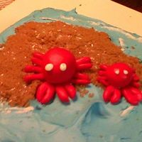 "Crab Birthday Cake Dark chocolate cake with buttercream. Crabs are made out of fondant with brown sugar ""sand."""