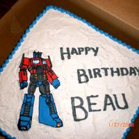 Optimus Prime Cake French vanilla cake with buttercream icing. Optimus Prime is a FBCT; my first attempt. I was pretty happy with how it turned out.