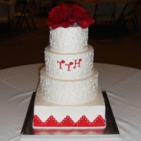 Wedding Cake iced in BC; red border is fondant