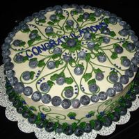 Blueberry Cake This cake was for my husband's co-worker....he told me after I put the design on the cake that it had to say Congratulations on it.......