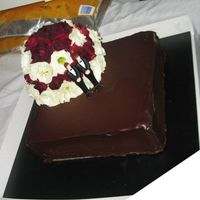 My Boys' Wedding Very dear friends of mine, I made their wedding cake. A large chocolate slab, coated in very yummy callebaut dark chocolate ganache with...