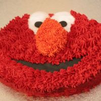 Elmo! This was a first birthday present for a friends daughter, basic buttercake underneath, aust buttercream icing, flavoured with orange oil,...