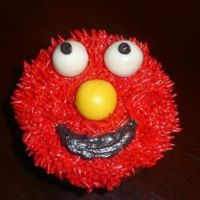 Elmo Smash Cake cupcake with elmo face on it for a 1st b-day smash cake