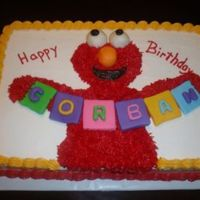 Corbans Elmo Cake Elmo with fondant block letters to spell name.