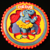 Circus Elephant Cookie This is a large (6 in./2.5 cm.) cookie inspired by a circus-themed party plate. Except for the blue background layer, which was lustered,...