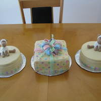 Baby Shower Trio Grouping of cakes for a friend's lamb themed baby shower. All Iced in buttercream with fondant lambs and bow. It's my first bow...