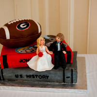 Josh's Groom Cake Thanks to JustBeck101!!! RKT football, covered in fondant. Everything hand made with fondant.