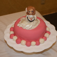 Maddie's Baptism Cake Fondant covered and fondant figure. Large main cake did not survive my daughter's (Maddie's mom) driving.