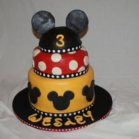 "Wesley's 3Rd Birthday Fondant covered except for ribbon around each tier. 10"", 8"", 6"" tiers"