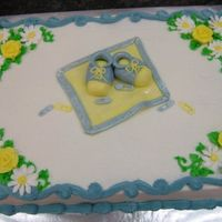 Baby Boy Cake this cake was made for a baby shower. The mother was expecting a little boy. The mother loved roses and dasies, they were made out of royal...