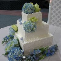 Square Wedding Cake White cake with buttercream frosting.