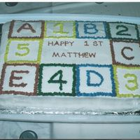 Block Birthday Cake This one I did for my first child's first birthday, we had a large party so I did a big sheet cake.