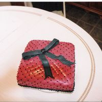 Red Gift This is a cake i did for my sister's bridal shower last month, she loved it. Her colors were a claret red and black, the red didn&#039...
