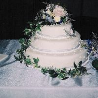 White Fondant Wedding Cake My first fondant wedding cake. Three stacked layers of carrot cake, coated in cream cheese icing, and white fondant. Decorated with royal...