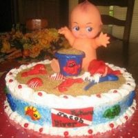 Beach Baby Diver Cake This cake was for a mom to be who loves to dive. Cake is frosted with buttercream. Animals and shells are all of MMF. Sand is raw sugar.