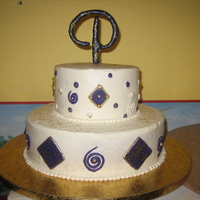 Tiered Purple And Gold Cake With Monogram I made this cake for my husband's grandmother. Her name is Pearlie so I made a P monogram to put on top. All the decorations are made...