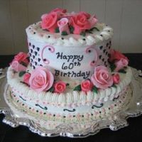 Pink And Black Cake With Pink Roses Cake is frosted with buttercream. Roses are hand molded out of MMF. Leaves are buttercream.