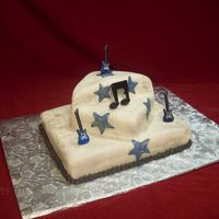 Rocker   This cake was actually for a baby shower. It is covered in fondant with pearl dust. The notes and guiter are picks.