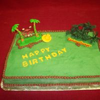 Curious George 1/4 sheet cake covered in buttercream