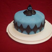 Blue Diamond 9 in covered in fondant. I used a cookie cutter to make diamonds.