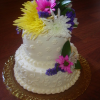 Small Backyard Wedding  A small cake for a backyard country wedding. 1 layer Chocolate zuchini cake & 1 layer french vanilla with raspberry filling. Fresh...