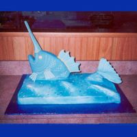 Sailing Swordfish This cake was designed for a deep sea fisherman's surprise birthday party. The head of the fish is half of a fondant covered fish pan...