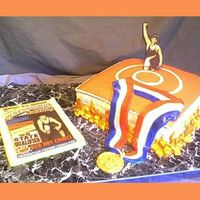 Bryan This graduation cake was designed for a high school state level wrestling grad. Edible image on photo/print shop magazine cover with...