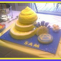 Lemon Sam a grad cake for a guy crazy about everything lemon, so of course the cake was lemon-poppy seed with lemon filling. his college logo is on...
