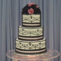 First Practice Wedding Cake Done at the wilton school in chicago. The gumpaste roses were my fav part of the cake.