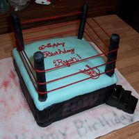 Wrestling Cake   This is my wrestling cake I did for my son. If was a battle to get done because my fondant would not work with me. Thanks for looking