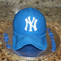 Yankees Cap chocolate cake covered in fondant made to look like a yankees cap