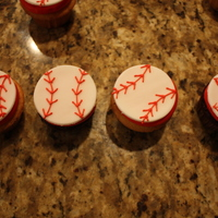 Baseball Cupcakes yellow and chocolate cupcakes with buttercream frosting and fondant cut out circles with royal icing stitching