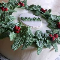 Christmas Wreath Cake Chocolate cake with Peppermint flavor IMBC.RI accents with Pearl dustI got a idea from Wilton Book.Thanks for looking.
