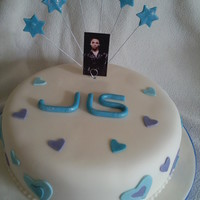 Jls Cake Vanilla sponge covered with sugarpaste. Flowerpaste stars.