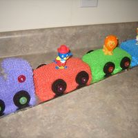 Backyardigan Circus Train Birthday Cake  Made from 4 pound cakes and Buttercream icing. I used Backyardigan bobble head circus toys on each car and caboose and a #2 candle for the...