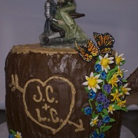"""fairy""tale Wedding Cake  I was asked for an unconventional wedding cake to go with the cake topper.Chocolate cake with buttercream filling, chocolate ganache icing..."