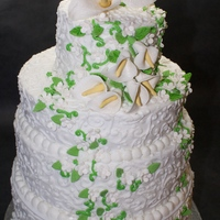 Cala Lily Wedding Cake   4 tier wedding cake covered in buttercream, piped scrollwork. Gumpaste Cala lilies & Butterflies.