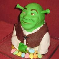 Shrek For Laurinha Laurinha wanted a Shrek cake! So this is what I came out with!It's pound cake with ganache and mmf. I made a tutorial for his face,...
