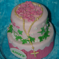 Anny's First Communion Cake I took my inspiration on a loveandsugar's cake here on CC. I made it for my niece Anny :-) Chocolate cake covered with ganache and MMF...