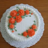 Orange Roses Cake I made to take to my parents in TN while we were visiting for Thanksgiving. Coconut cake, all vanilla buttercream.