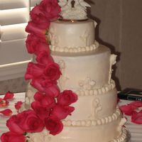 Cascade Wedding cake for 150. Used a figure groom gave bride in 1999 as their topper. TFL