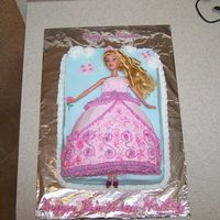 Pretty As A Princess Strawberry cake with strawberry filling on 9x13 cake. Dress is half of the football pan. Iced in bc. Doll is full sized and covered with...