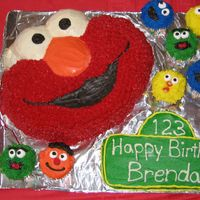 Elmo And Sesame Street Characters Hi all! This was for my son's 2nd birthday. Elmo is from the Wilton pan and is all buttercream. I carved the Sesame St sign out of a 9...